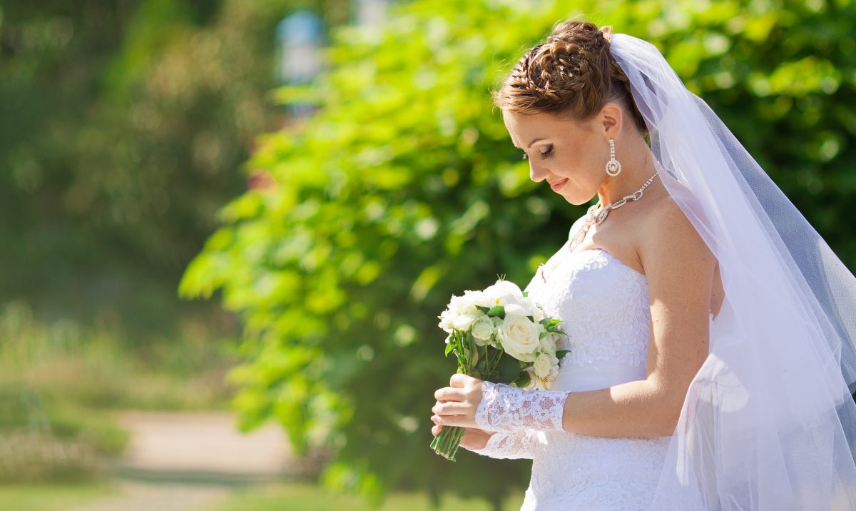 Bride outdoors promoting Browns wedding dress preservation